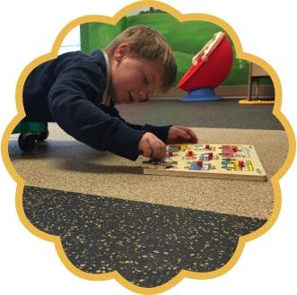 Boy doing a puzzle
